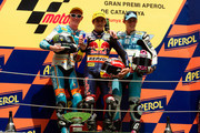 L-R Bradley Smith of Great Britain and Bancaja Aspar Team, Marc Marquez of Spain and Red Bull AJo Motorsport and Pol Espargaro of Spain and Tuenti Racing pose and celebrate on the podium at the end of 125 cc race of MotoGP of Catalunya in Catalunya circuit on July 4, 2010 in Montmelo, Spain.
