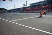 Marc Marquez of Spain and Repsol Honda Team cuts the finish lane anc celebrates the MotoGP victory and becoming the 2018 MotoGP champion at the end of the MotoGP race during the MotoGP of Japan - Race at Twin Ring Motegi on October 21, 2018 in Motegi, Japan.