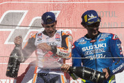 Marc Marquez of Spain and Repsol Honda Team celebrates the MotoGP victory and becoming the 2018 MotoGP champion at the end of the MotoGP race on the podium with Alex Rins of Spain and Team Suzuki ECSTAR   (R) during the MotoGP of Japan - Race at Twin Ring Motegi on October 21, 2018 in Motegi, Japan.