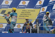 (L-R) Nico Terol of Spain and Bancaja Aspar Team; Marc Marquez of Spain and Red Bull AJo Motorsport and Pol Espargaro of Spain and Tuenti Racing celebrate on the podium and spray champagne at the end of the 125 cc race of the MotoGP of Malaysia at Sepang International Circuit on October 10, 2010 in Kuala Lumpur, Malaysia.