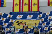 (L-R) Pol Espargaro of Spain and Tuenti Racing, Marc Marquez of Spain and Red Bull AJo Motorsport and Nico Terol of Spain and Bancaja Aspar Team pose on the podium at the end of the 125 cc race of the MotoGP of Malaysia at Sepang International Circuit on October 10, 2010 in Kuala Lumpur, Malaysia.