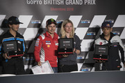 (L-R) Francesco Bagnaia of Italy and Sky Racing Team VR46, Jorge Lorenzo of Spain and Ducati Team and Jorge Martin of Spain and Del Conca Gresini Moto celebrate the Pole Position during the press conference at the end of the qualfying practice during the MotoGp Of Great Britain - Qualifying at Silverstone Circuit on August 25, 2018 in Northampton, England.