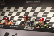 (L-R) Marc Marquez of Spain and Repsol Honda Team,  Valentino Rossi of Italy and Yamaha Factory Racing and  Cal Crutchlow of Great Britain and Monster Yamaha Tech 3 pose during the press conference  at the end of the MotoGP race during the MotoGp Of Holland - Race at TT Circuit Assen on June 29, 2013 in Assen, Netherlands.
