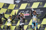 (L-R) Alex Rins of Spain and Pagina Amarillas HP40 , Johann Zarco of French and AJO Motorsport and Esteve Rabat of Spain and Estrella Galicia 0,0 Marc VDS celebrate on the podium at the end of the Moto2 race during the MotoGp of Catalunya - Race at Circuit de Catalunya on June 14, 2015 in Montmelo, Spain.