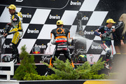 (L-R) Thomas Luthi of Switzerland and Interwetten Paddock,  Marc Marquez of Spain and Team Catalunya Caixa Repsol and  Pol Espargaro of Spain and Pons 40 HP Tuenti  celbrate and spray champagne on the podium  at the end of the Moto2 race of the MotoGp of Czech Republic at Brno Circuit on August 26, 2012 in Brno, Czech Republic.