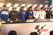 (L-R) Aleix Espargaro of Spain and Team Suzuki MotoGP, Marc Marquez of Spain and Repsol Honda Team, Jorge Lorenzo of Spain and Movistar Yamaha MotoGP;  Valentino Rossi of Italy and Movistar Yamaha MotoGP; Andrea Iannone of Italy and Ducati Team; Cal Crutchlow of Great Britain and CWM LCR Honda and Stefan Bradl of Germany and Athina Forward Racing pose during the press conference pre-event during the MotoGp of Germany - Previews at Sachsenring Circuit on July 9, 2015 in Hohenstein-Ernstthal, Germany.