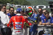 Valentino Rossi of Italy and Movistar Yamaha MotoGP celebrates with Jorge Lorenzo of Spain and Ducati Team (L)  at the end of the qualifying practice during the MotoGp of Italy - Qualifying at Mugello Circuit on June 2, 2018 in Scarperia, Italy.