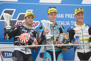 (L-R) Esteve Rabat of Spain and Estrella Galicia 0,0 Marc VDS,  Johann Zarco of French and AJO Motorsport and Dominique Aegerter of Switzerland and Technomag Racing celebrate on the podium at the end of the Moto2 race during the MotoGp of Italy - Race. at Mugello Circuit on May 31, 2015 in Scarperia, Italy.