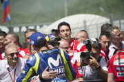 Valentino Rossi of Italy and Movistar Yamaha MotoGP celebrates  with Jorge Lorenzo of Spain and Ducati Team (L) under the podium at the end of the MotoGP race during the MotoGp of Italy - Race at Mugello Circuit on June 3, 2018 in Scarperia, Italy.
