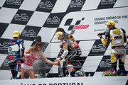 (L-R) Pol Espargaro of Spain and Pons 40 HP Tuenti, Marc Marquez of Spain and Team Catalunya Caixa Repsol  and  Thomas Luthi of Switzerland and Interwetten Paddock celebrate on the podium at the end of the Moto2 race of the  MotoGp of Portugal at  on May 6, 2012 in Estoril, Portugal.