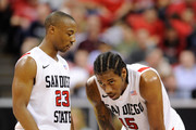 D.J. Gay #23 of the San Diego State Aztecs talks to teammate Kawhi Leonard #15 during a semifinal game of the Conoco Mountain West Conference Basketball tournament at the Thomas & Mack Center March 11, 2011 in Las Vegas, Nevada. San Diego State won 74-72.