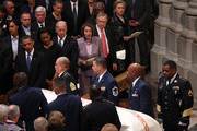 U.S. President Barack Obama watches pall bearers carry the coffin during the funeral service for civil rights leader Dorothy Height with (L-R) first lady Michelle Obama, U.S. Vice President Joe Biden, Speaker of the House Nancy Pelosi (D-CA), Senate Majority Leader Harry Reid (D-NV), Rep. Jim Clyburn (D-SC) and Secretary of State Hillary Clinton at the Washington National Cathedral April 29, 2010 in Washington, DC. Height led the National Council of Negro Women and marched with the Rev. Martin Luther King Jr.