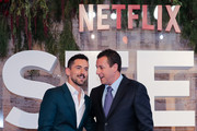 Luis Gerardo Mendez and Adam Sandler joke on the red carpet before 'Murder Mystery' premiere at Antara Polanco Fashion Hall on June 12, 2019 in Mexico City, Mexico.
