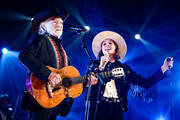 Willie Nelson (L) and Brandi Carlile perform at MusiCares Person of the Year honoring Dolly Parton at Los Angeles Convention Center on February 08, 2019 in Los Angeles, California.