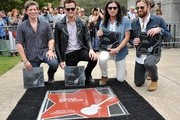 (L-R) Matthew Followill, Jared Followill, Nathan Followill and Caleb Followill pose with plaques at their star on the Music City Walk Of Fame Induction Ceremony Honoring Kings Of Leon at Walk of Fame Park on September 21, 2012 in Nashville, Tennessee.