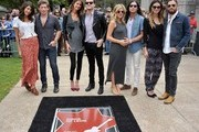 (L-R) Matthew Followill and wife Johanna Bennett, Jared Followill and fiancee Martha Patterson, Nathan Followill and wife Jessie Baylin and Caleb Followill and wife Lily Aldridge attend the Music City Walk Of Fame Induction Ceremony Honoring Kings Of Leon at Walk of Fame Park on September 21, 2012 in Nashville, Tennessee.