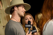 Brian Kelley of Florida Georgia Line and Brittney Marie Cole attend Off The Record High End Fashion event on November 1, 2015 in Nashville, Tennessee. Featuring national designers John Varvatos, Gucci, Johnathan Kayne among others with artists Old Dominion, Maren Morris, Phil Vassar, Big Kenny, and more. Produced by Neste Event Marketing/EntertainmentBuy's Gil and Liz Cunningham, coordinated by Jessica Beattie with celebrity stylist Christiev Alphin.