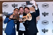 (L-R) Radio Host Bobby Bones, Musicians On Call President Pete Griffin and Recording Artist and Actor Charles Esten arrive at CMA Theater at the Country Music Hall  of Fame and Museum on October 10, 2018 in Nashville, Tennessee.