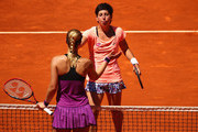 Carla Suarez Navarro of Spain shakes hands at the net after her straight sets victory against Sabine Lisicki of Germany in their second round match during day four of the Mutua Madrid Open tennis tournament at the Caja Magica on May 03, 2016 in Madrid,Spain.