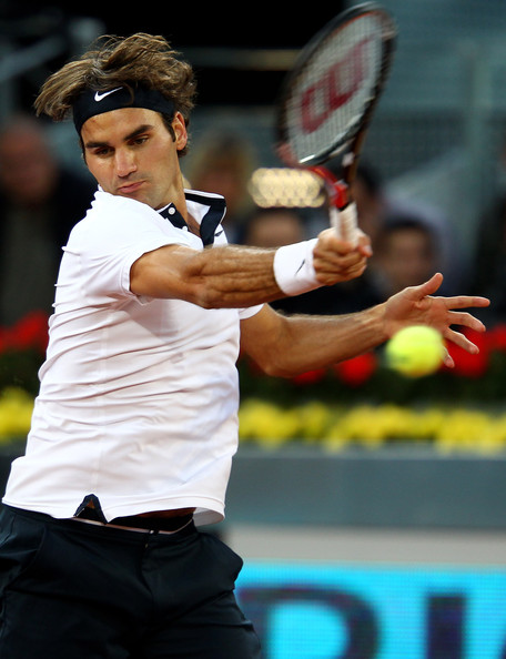 Roger Federer of Switzerland  plays a forehand against Ernests Gulbis of Latvia in their quarter final match during the Mutua Madrilena Madrid Open tennis tournament at the Caja Magica on May 14, 2010 in Madrid, Spain.