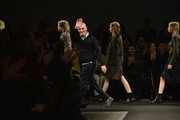 Fashion designer Alessandro dell'Acqua walks the runway after the N 21 fashion show during Milan Fashion Week Womenswear Autumn/Winter 2014 on February 19, 2014 in Milan, Italy.