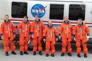 (R-L) Space Shuttle Atlantis Commander Ken Ham, Pilot Tony Antonelli, Mission Specialists Garrett Reisman, Michael Good, Steve Bowen and Piers Sellers walk out of NASA's operations and checkout building and into the astronaut van at Kennedy Space Center May 14, 2010 in Cape Canaveral in preparation for their launch later today. This is scheduled to be the final launch for Atlantis.
