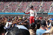 Kyle Busch, driver of the #18 Sport Clips Toyota, waves to fans as he is introduced before the NASCAR Cup Series FanShield 500 at Phoenix Raceway on March 08, 2020 in Avondale, Arizona.