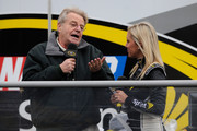 (L) TV personality Jerry Springer talks with Miss Sprint Jaclyn Roney at the Coca-Cola Fan Zone outside the Hard Rock Hotel & Casino on December 1, 2011 in Las Vegas, Nevada.