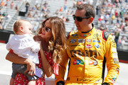 Kyle Busch, driver of the #18 M&M's Toyota, stands on the grid with wife Samantha Busch and son Brexton prior to the NASCAR Sprint Cup Series Food City 500 at Bristol Motor Speedway on April 17, 2016 in Bristol, Tennessee.