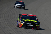 Clint Bowyer, driver of the #15 5-Hour Energy Toyota, leads Martin Truex Jr., driver of the #78 Furniture Row/Visser Precision Chevrolet, during the NASCAR Sprint Cup Series Pure Michigan 400 at Michigan International Speedway on August 16, 2015 in Brooklyn, Michigan.