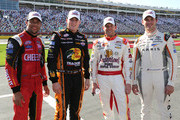 (L-R) Darrell Wallace Jr., driver of the #6 Cheez-It Ford, Ty Dillon, driver of the #3 Bass Pro Shops/NWTF.org Chevrolet, Regan Smith, driver of the #7 Anderson's Pure Maple Syrup Chevrolet, and Daniel Suarez, driver of the #18 ARRIS Toyota, pose for a photo on the grid after the NASCAR XFINITY Series Hisense 300 at Charlotte Motor Speedway on May 23, 2015 in Charlotte, North Carolina.