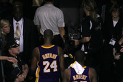 Kobe Bryant #24, Ron Artest #37 and Pau Gasol #16 of the Los Angeles Lakers walk back to the locker room after the Celtics own 96-89 against the Boston Celltics during Game Four of the 2010 NBA Finals on June 10, 2010 at TD Garden in Boston, Massachusetts. NOTE TO USER: User expressly acknowledges and agrees that, by downloading and/or using this Photograph, user is consenting to the terms and conditions of the Getty Images License Agreement.