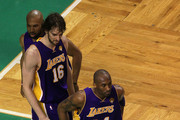 Kobe Bryant #24, Pau Gasol #16 and Derek Fisher #2 of the Los Angeles Lakers look on in the first half against the Boston Celtics during Game Five of the 2010 NBA Finals on June 13, 2010 at TD Garden in Boston, Massachusetts. NOTE TO USER: User expressly acknowledges and agrees that, by downloading and/or using this Photograph, user is consenting to the terms and conditions of the Getty Images License Agreement.