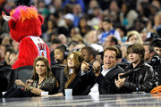 (L-R) Maria Shriver, Christina Schwarzenegger, Governor of California Arnold Schwarzenegger and Patrick Schwarzenegger in the audience during the NBA All-Star Game held at Cowboys Stadium on February 14, 2010 in Arlington, Texas.