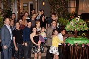 """The cast and executives of """"Parenthood"""" pose at NBC's """"Parenthood"""" 100th episode cake-cutting ceremony at Universal Studios on November 7, 2014 in Universal City, California."""
