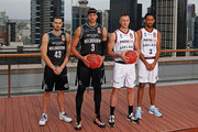 Josh Boone and Chris Goulding of Melbourne United along with Mitch Creek and Josh Childress of the Adelaide 36ers pose with the Dr John Raschke Trophy during the NBL Grand Final media opportunity at 333 Collins St on March 15, 2018 in Melbourne, Australia.