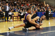 Andrew Bogut of the Sydney Kings (L) reacts after tackling Chris Goulding of Melbourne United during the NBL pre-season match between Melbourne United and the Sydney Kings at State Basketball Centre on September 1, 2018 in Melbourne, Australia.