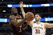 A.J. English #5 of the Iona Gaels makes a shot over Georges Niang #31 of the Iowa State Cyclones during the first round of the 2016 NCAA Men's Basketball Tournament at the Pepsi Center on March 17, 2016 in Denver, Colorado.
