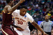 Deonte Burton #30 of the Iowa State Cyclones drives the ball around A.J. English #5 of the Iona Gaels during the first round of the 2016 NCAA Men's Basketball Tournament at the Pepsi Center on March 17, 2016 in Denver, Colorado.