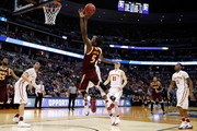 A.J. English #5 of the Iona Gaels shoots the ball over Jameel McKay #1 of the Iowa State Cyclones  in the first half during the first round of the 2016 NCAA Men's Basketball Tournament at the Pepsi Center on March 17, 2016 in Denver, Colorado.