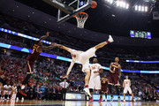 Abdel Nader #2 of the Iowa State Cyclones is foulded by A.J. English #5 of the Iona Gaels during the first round of the 2016 NCAA Men's Basketball Tournament at the Pepsi Center on March 17, 2016 in Denver, Colorado.