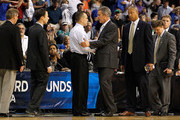 Head coach Bob Williams (center R) of the UC Santa Barbara Gauchos congratulates head coach Billy Donovan of the Florida Gators after FLorida won 79-51 during the second round of the 2011 NCAA men's basketball tournament at St. Pete Times Forum on March 17, 2011 in Tampa, Florida.