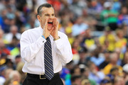Head coach Billy Donovan of the Florida Gators yells to his team in the second half against the Michigan Wolverines during the South Regional Round Final of the 2013 NCAA Men's Basketball Tournament at Dallas Cowboys Stadium on March 31, 2013 in Arlington, Texas.