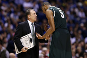 Head coach Tom Izzo of the Michigan State Spartans talks with Adreian Payne #5 against the Duke Blue Devils during the Midwest Region Semifinal round of the 2013 NCAA Men's Basketball Tournament at Lucas Oil Stadium on March 29, 2013 in Indianapolis, Indiana.