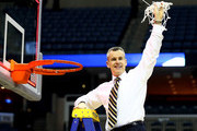 Head coach Billy Donovan of the Florida Gators cuts the net after defeating the Dayton Flyers 62-52 in the south regional final of the 2014 NCAA Men's Basketball Tournament at the FedExForum on March 29, 2014 in Memphis, Tennessee.
