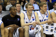 (L-R) Nolan Smith #2, Kyle Singler #12 and Mason Plumlee #5 of the Duke Blue Devils sit on the bench in the second half while taking on the Hampton Pirates during the second round of the 2011 NCAA men's basketball tournament at Time Warner Cable Arena on March 18, 2011 in Charlotte, North Carolina.