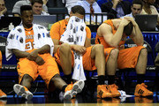 (L-R) Scotty Hopson #32, Brian Williams #33 and Steven Pearl #22 of the Tennessee Volunteers sit on the bench late in the second half before losing to the Michigan Wolverines 75-45 during the second round of the 2011 NCAA men's basketball tournament at Time Warner Cable Arena on March 18, 2011 in Charlotte, North Carolina.