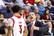 Rick Pitino and Peyton Siva Photos Photo