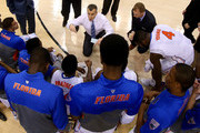 Head coach Billy Donovan of the Florida Gators talks with his team as they huddle while taking on the Pittsburgh Panthers during the third round of the 2014 NCAA Men's Basketball Tournament at Amway Center on March 22, 2014 in Orlando, Florida.
