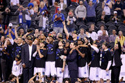 """Head coach Mike Krzyzewski of the Duke Blue Devils watches """"One Shining Moment"""" with his team after defeating the Wisconsin Badgers during the NCAA Men's Final Four National Championship at Lucas Oil Stadium on April 6, 2015 in Indianapolis, Indiana. Duke defeated Wisconsin 68-63."""